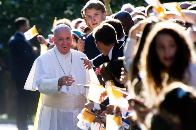 Pope Francis shakes hands with school children as he departs the Apostolic Nunciature, the Vatican's diplomatic mission in Washington, Wednesday, Sept. 23, 2015. Pope Francis will visit the White House, becoming only the third pope to visit the White House.  (AP Photo/Cliff Owen)